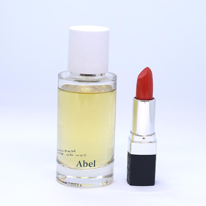 Abel Eau De Parfum in Cobalt Amber; Bellapierre Lipstick in Mandarina